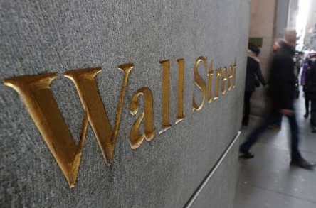 FILE PHOTO: A street sign, Wall Street, is seen outside New York Stock Exchange (NYSE) in New York City, New York, U.S., January 3, 2019. REUTERS/Shannon Stapleton/File Photo