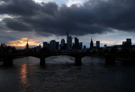 FILE PHOTO: Dark clouds hang over the financial district as the spread of the coronavirus disease (COVID-19) continues in Frankfurt, Germany, March 16, 2021. REUTERS/Kai Pfaffenbach