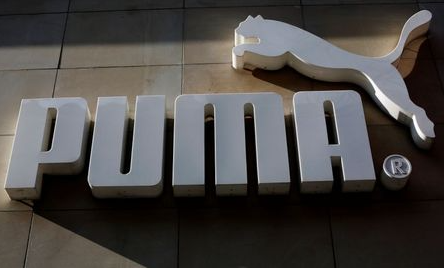 The logo of German sports goods firm Puma is seen at the entrance of one of its stores in Vienna, Austria, March 18, 2016. REUTERS/Leonhard Foeger
