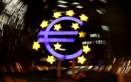 FILE PHOTO: The euro sign is photographed in front of the former head quarter of the European Central Bank in Frankfurt, Germany, April 9, 2019. Picture is taken on slow shutter speed while the camera was moved. REUTERS/Kai Pfaffenbach/File Photo