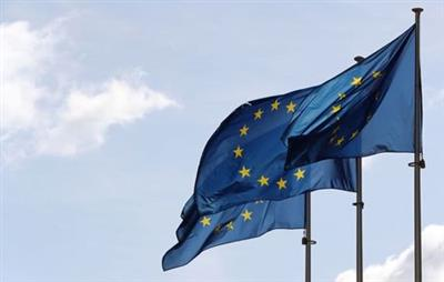 FILE PHOTO: The European Union flags flutter ahead of the gas talks between the EU, Russia and Ukraine at the EU Commission headquarters in Brussels, Belgium September 19, 2019. REUTERS/Yves Herman