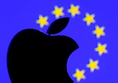 A 3D-printed Apple logo is seen in front of a displayed European Union flag in this illustration taken September 2, 2016. REUTERS/Dado Ruvic/Illustration