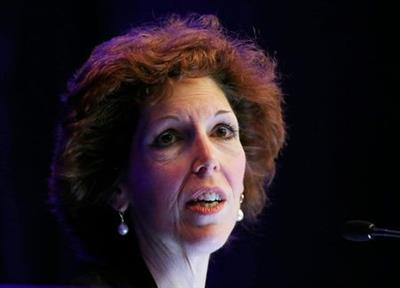 Cleveland Federal Reserve Bank President and CEO Loretta Mester gives her keynote address at the 2014 Financial Stability Conference in Washington December 5, 2014. The Federal Reserve should not rush to raise interest rates to head off risky financial-market bubbles because its usefulness remains