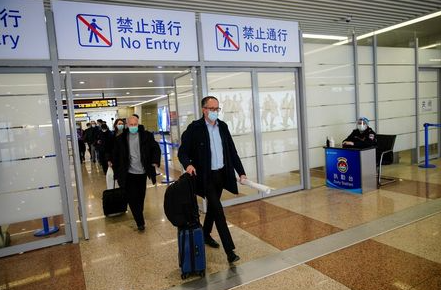 Peter Ben Embarek, and other members of the World Health Organisation (WHO) team tasked with investigating the origins of the coronavirus disease (COVID-19), arrive at the Pudong International Airport in Shanghai, China February 10, 2021. REUTERS/Aly Song