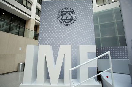 FILE PHOTO: International Monetary Fund logo is seen inside the headquarters at the end of the IMF/World Bank annual meetings in Washington, U.S., October 9, 2016. REUTERS/Yuri Gripas/File Photo