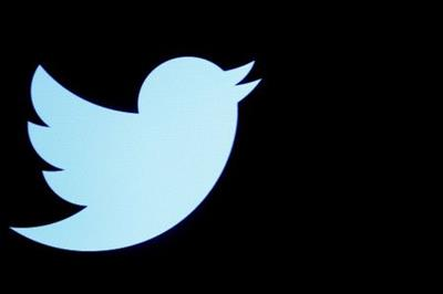 FILE PHOTO: The Twitter logo is displayed on a screen on the floor of the New York Stock Exchange (NYSE) in New York City, U.S., September 28, 2016. REUTERS/Brendan McDermid/File Photo