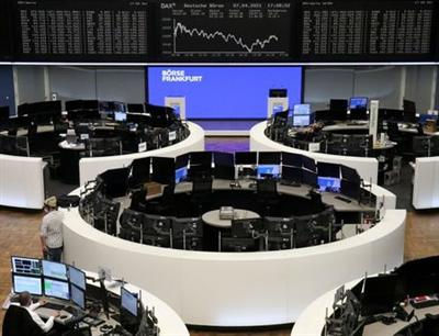 FILE PHOTO: The German share price index DAX graph is pictured at the stock exchange in Frankfurt, Germany, April 7, 2021. REUTERS/Staff