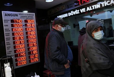 People wait to change money at a currency exchange office in Istanbul, Turkey?March 22, 2021. REUTERS/Murad Sezer