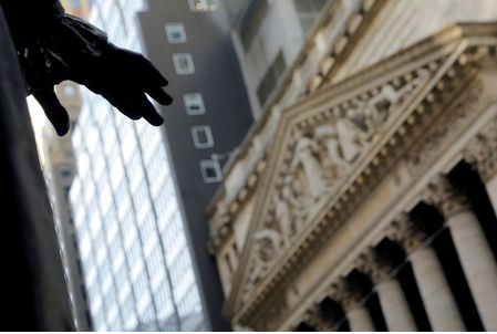 FILE PHOTO: The hand of a sculpture of former U.S. President George Washington is pictured with the facade of the New York Stock Exchange (NYSE) in Manhattan in New York City, New York, U.S., January 28, 2021. REUTERS/Mike Segar/File Photo