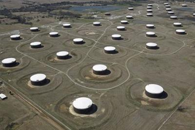 FILE PHOTO: Crude oil storage tanks are seen from above at the Cushing oil hub, in Cushing, Oklahoma, U.S., March 24, 2016. REUTERS/Nick Oxford