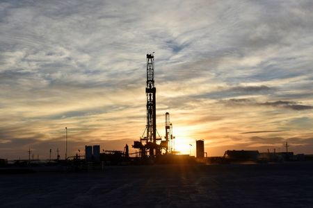 Drilling rigs operate at sunset in Midland, Texas, U.S., February 13, 2019. Picture taken February 13, 2019. REUTERS/Nick Oxford