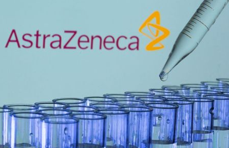 Test tubes are seen in front of a displayed AstraZeneca logo in this illustration taken, May 21, 2021. REUTERS/Dado Ruvic/Illustration