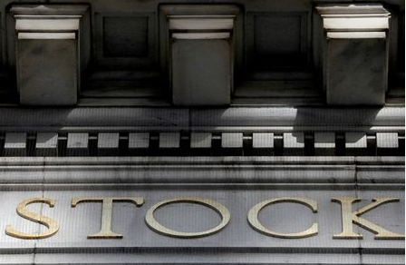 FILE PHOTO: Morning sunlight falls on the facade of the New York Stock Exchange (NYSE) building after the start of Thursday's trading session in Manhattan in New York City, New York, U.S., January 28, 2021. REUTERS/Mike Segar/File Photo
