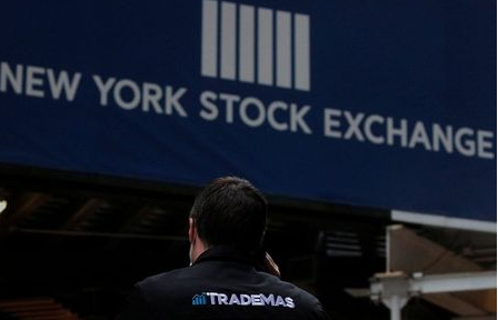 Trader Frank Masiello talks on his phone on Wall St. outside the New York Stock Exchange (NYSE) in New York, U.S., January 15, 2021. REUTERS/Brendan McDermid