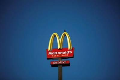 The McDonald's company logo stands on a sign outside a restaurant in Bretigny-sur-Orge, near Paris, France, July 30, 2020. REUTERS/Benoit Tessier