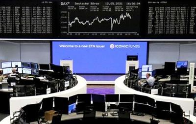 FILE PHOTO: The German share price index DAX graph is pictured at the stock exchange in Frankfurt, Germany, May 12, 2021. REUTERS/Staff