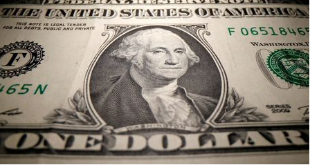 FILE PHOTO: A U.S. Dollar banknote is seen in this illustration taken May 26, 2020. REUTERS/Dado Ruvic/Illustration/File Photo/File Photo