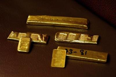 Gold ingots, inscribed with details, are displayed at a wholesale gold shop, as the coronavirus disease (COVID-19) outbreak continues, in Peshawar, Pakistan August 6, 2020. REUTERS/Fayaz Aziz