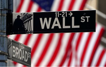 FILE PHOTO: A Wall Street sign is pictured outside the New York Stock Exchange in the Manhattan borough of New York City, New York, U.S., April 16, 2021. REUTERS/Carlo Allegri/File Photo