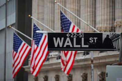 The Wall St. sign is seen outside The New York Stock Exchange (NYSE) in New York, U.S., February 16, 2021. REUTERS/Brendan McDermid
