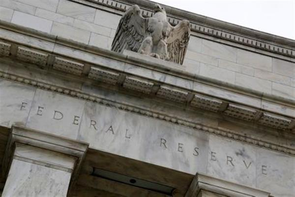 An eagle tops the U.S. Federal Reserve building's facade in Washington, July 31, 2013. REUTERS/Jonathan Ernst (UNITED STATES - Tags: POLITICS BUSINESS)