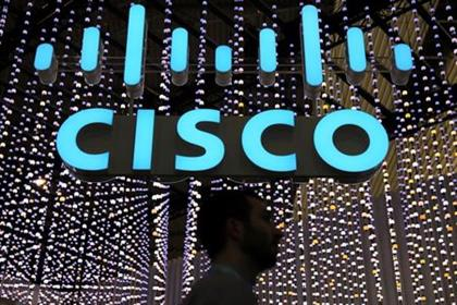 A man passes under a Cisco logo at the Mobile World Congress in Barcelona, Spain February 25, 2019. REUTERS/Sergio Perez