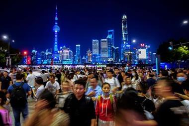 People walk along near the Bund, in front of Lujiazui financial district of Pudong, following the outbreak of the coronavirus disease (COVID-19), in Shanghai, China May 10, 2021. REUTERS/Aly Song