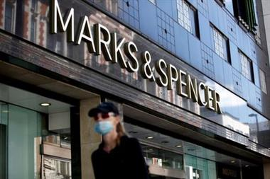 FILE PHOTO: A woman walks past a Marks & Spencer store at Oxford Street, amid the outbreak of the coronavirus disease (COVID-19), in London, Britain, July 20, 2020. REUTERS/Henry Nicholls