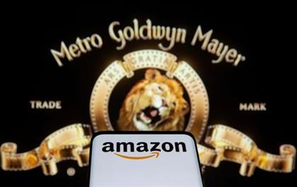 FILE PHOTO: Smartphone with Amazon logo is seen in front of displayed MGM logo in this illustration taken, May 26, 2021. REUTERS/Dado Ruvic/Illustration