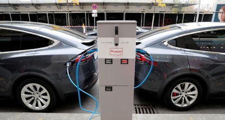FILE PHOTO: Tesla Model X electric cars recharge their batteries in Berlin, Germany, November 13, 2019. REUTERS/Fabrizio Bensch/File Photo