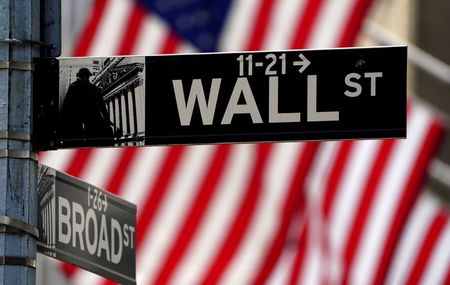 FILE PHOTO: A Wall Street sign outside the New York Stock Exchange in the Manhattan borough of New York City, New York, U.S., April 16, 2021. REUTERS/Carlo Allegri/File Photo