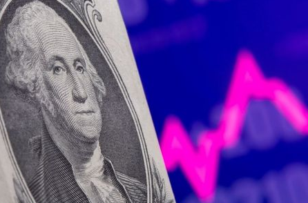 A U.S. one dollar banknote is seen in front of displayed stock graph in this illustration taken May 7, 2021. REUTERS/Dado Ruvic/Illustration
