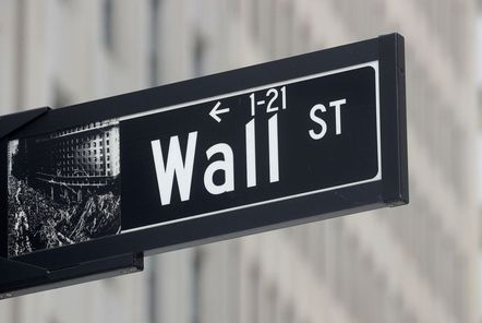 The Wall St. sign is seen near the New York Stock Exchange (NYSE) in New York City, U.S., May 4, 2021. REUTERS/Brendan McDermid