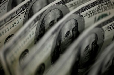 FILE PHOTO: A picture illustration shows U.S. 100-dollar bank notes taken in Tokyo August 2, 2011. REUTERS/Yuriko Nakao/File Photo