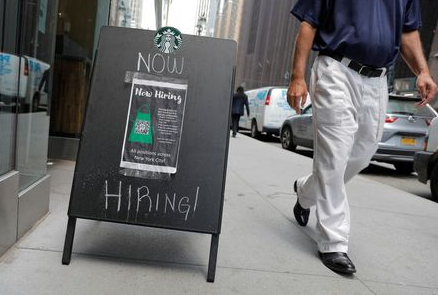 A sign advertising job openings is seen outside of a Starbucks in Manhattan, New York City, New York, U.S., May 26, 2021. REUTERS/Andrew Kelly