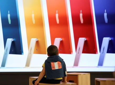 A child looks on at the Apple's new flagship store on the day it opens on Rome's main shopping street, Via del Corso, in Rome, Italy, May 27, 2021. REUTERS/Yara Nardi