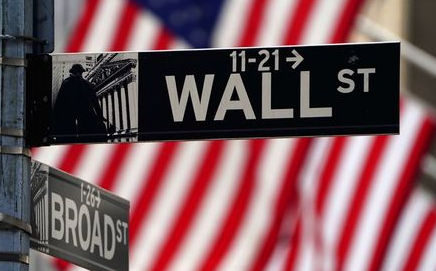A Wall Street sign is pictured outside the New York Stock Exchange amid the coronavirus disease (COVID-19) pandemic in the Manhattan borough of New York City, New York, U.S., April 16, 2021. REUTERS/Carlo Allegri