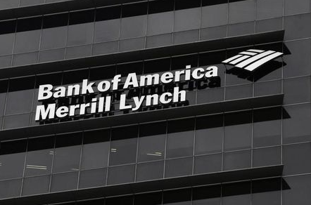 A Bank of America Merrill Lynch sign is seen on a building that houses its offices in Singapore May 17, 2012. Royal Bank of Canada and Credit Suisse are among the suitors seeking to bid for the non-U.S. wealth management businesses of Bank of America Merrill Lynch, sources told Reuters, in a deal that could be worth around $2 billion. REUTERS/Tim Chong (SINGAPORE - Tags: BUSINESS LOGO)