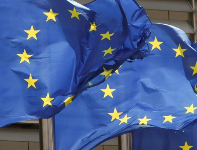 FILE PHOTO: European Union flags flutter outside the EU Commission headquarters in Brussels, Belgium May 5, 2021. REUTERS/Yves Herman/File Photo