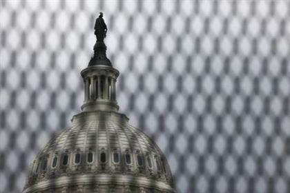 The U.S. Capitol building is seen behind security fencing that has been up around the building since shortly after the January 6, 2021 siege, after legislation to create a bipartisan commission to investigate the January 6 assault by supporters of former President Donald Trump failed by a vote of 54-35 due to a Republican filibuster, on Capitol Hill in Washington, May 28, 2021. REUTERS/Evelyn Hockstein