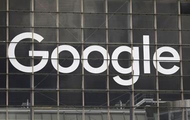 The logo of Google is seen on a building at la Defense business and financial district in Courbevoie near Paris, France, September 1, 2020. REUTERS/Charles Platiau