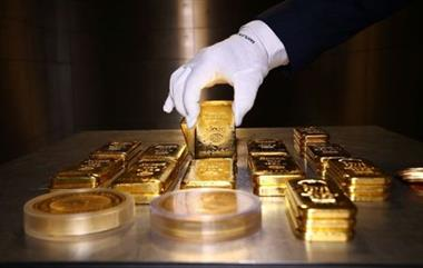 FILE PHOTO: Gold bars and coins are stacked in the safe deposit boxes room of the Pro Aurum gold house in Munich, Germany, August 14, 2019. REUTERS/Michael Dalder/File photo