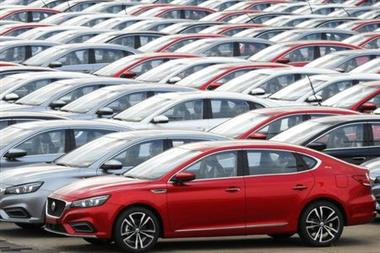 FILE PHOTO: Cars for export wait to be loaded onto cargo vessels at a port in Lianyungang, Jiangsu province, China October 14, 2019. REUTERS/Stringer