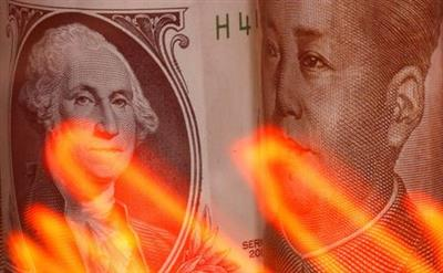 Chinese Yuan and U.S. dollar banknotes are seen behind illuminated stock graph in this illustration taken February 10, 2020. REUTERS/Dado Ruvic/Illustration
