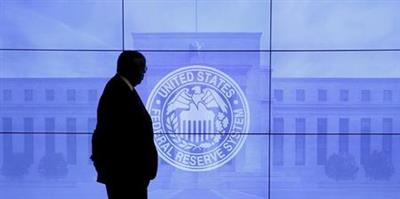 FILE PHOTO: A security guard walks in front of an image of the Federal Reserve in Washington, DC, U.S., March 16, 2016. REUTERS/Kevin Lamarque/File Photo