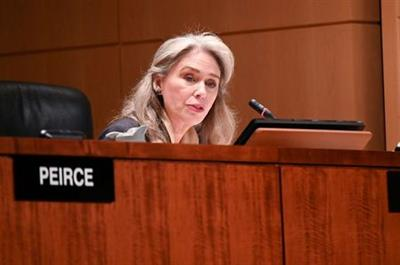 """FILE PHOTO: Commissioner Allison Lee participates in a U.S Securities and Exchange Commission open meeting to propose changing its decades-old definition of an """"accredited investor"""" in order to allow more Americans to buy shares in private companies, in Washington, U.S., December 18, 2019. REUTERS/Erin Scott/File Photo"""