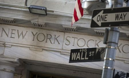 A Wall St. sign is seen outside the entrance of the New York Stock Exchange in New York's financial district August 13, 2015. REUTERS/Brendan McDermid