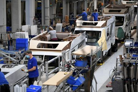 FILE PHOTO: Workers assemble campers at Knaus-Tabbert AG factory in Jandelsbrunn near Passau, Germany, March 16, 2021. Picture taken March 16, 2021. REUTERS/Andreas Gebert/File Photo