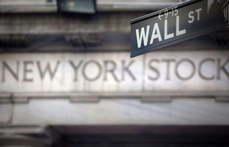 FILE PHOTO: A Wall Street sign is pictured outside the New York Stock Exchange in New York, October 28, 2013. REUTERS/Carlo Allegri