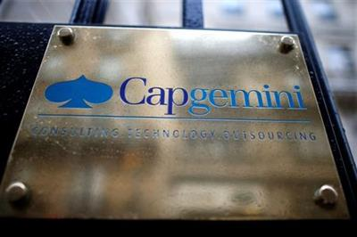 The logo of Cap Gemini is seen at the entrance of the company headquarters in Paris, France, February 18, 2016. REUTERS/Charles Platiau/File Photo GLOBAL BUSINESS WEEK AHEAD PACKAGE - SEARCH 'BUSINESS WEEK AHEAD 24 OCT' FOR ALL IMAGES